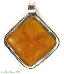 Tibetan Amber Colored Pendant Silver Repoussee