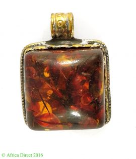 Tibetan Pendant Silver Repoussee Amber Color